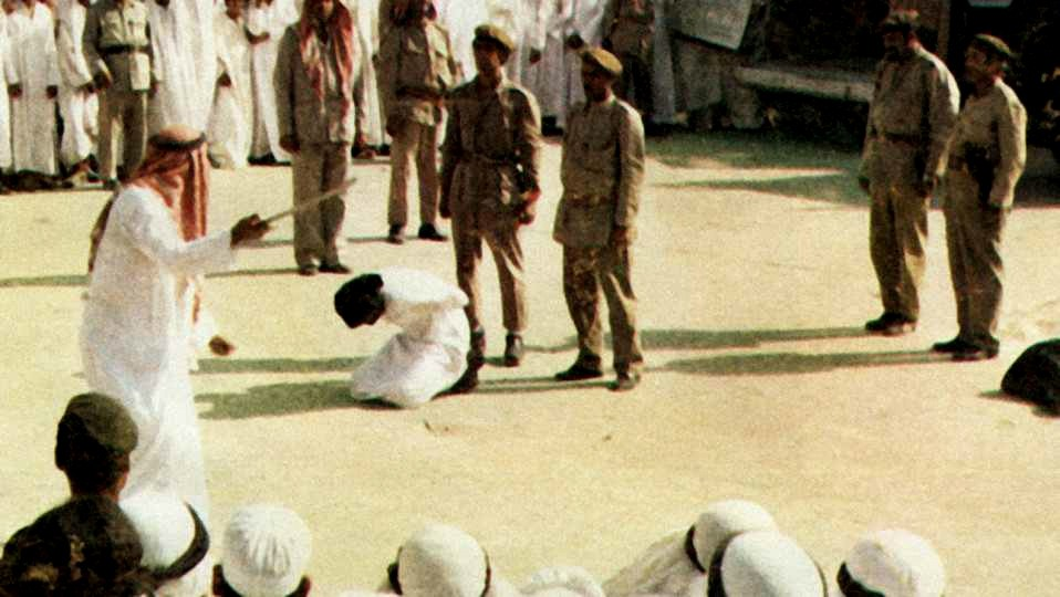 A public beheading taking place in a busy Saudi square.