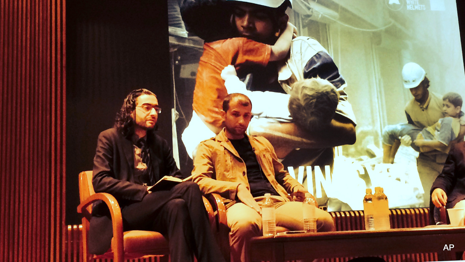 Read Saleh left, the head of the civil defense units in the northern city of Idlib, and Farouk al-Habib, right, a media campaigner for the White Helmets, sit on a panel to draw attention to their work in Syria in midtown New York, September, 2014.