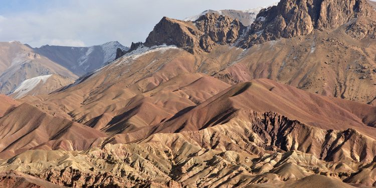 """""""Afghanistan rugged red mountains partly covered with snow, Bamyan Province"""""""